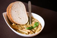 Dish of pasta with bread. Dish of pasta with slices of bread stock photo
