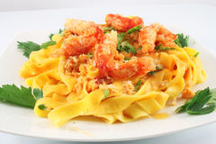 Dish with pasta fettuccine and crab meat Stock Photo