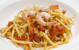 Dish of pasta with a tomatoe shrimp Stock Photos