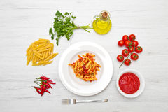 Dish with penne and arrabbiata sauce Royalty Free Stock Photo