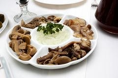 Pickled mushrooms on a plate Royalty Free Stock Photography