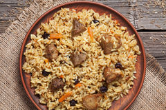 Dish of pilaf, national uzbek spicy meal with meat Royalty Free Stock Photos