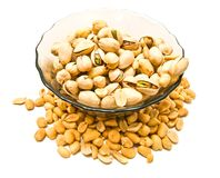 Dish with pistachios and peanuts. On white Royalty Free Stock Image
