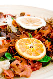 A dish of potpourri. With a dried slice of orange (1 Royalty Free Stock Photo