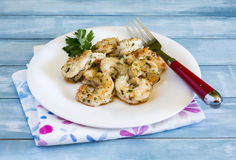 Dish with prawns and prawns with garlic Stock Images