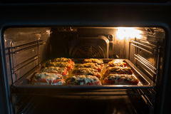A dish are prepared in the oven Stock Photos