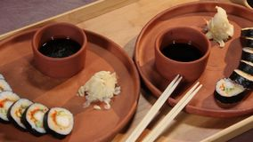 Dish presentation, Japanese sushi rolls served for two persons. Stock footage stock video footage