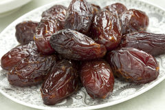 Dish with preserved Medjool dates Royalty Free Stock Image