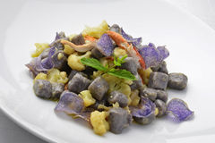 Dish of Purple Potato Dumpligs with  Cauliflower and Lobster 1. Dish of Purple Potato Dumpligs with  Cauliflower and Lobster in white plate Royalty Free Stock Images