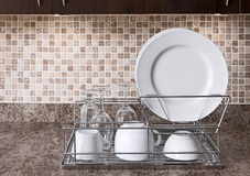 Dish rack on kitchen countertop Royalty Free Stock Image