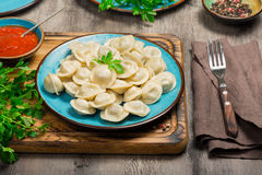 A dish with ravioli on the wooden board. Close up Royalty Free Stock Photo