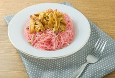 Dish of Red Fried Rice Noodle with Eggs and Scallion Royalty Free Stock Image