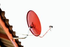 Dish. Red dish sticks on a roof  be pregnant the sky is white Royalty Free Stock Image