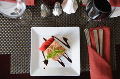 Dish and red wine. A restaurant table with a plate of food and a glass of red wine stock photography
