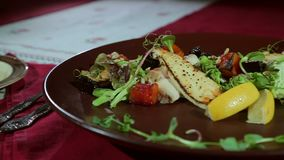 The dish at the restaurant. Dish in the restaurant on the table served stock video footage