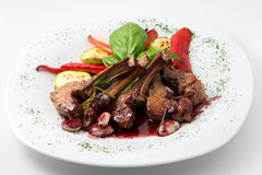 The dish of ribs in red wine with vegetables Stock Photos