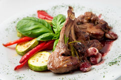 The dish of ribs in red wine with vegetables Stock Photo