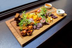 Dish with ribs and vegetables on table Royalty Free Stock Photography