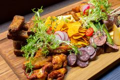 Dish with ribs and vegetables on table Royalty Free Stock Image