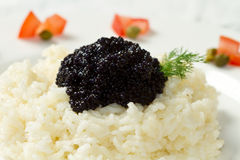 Rice with black caviar Stock Images