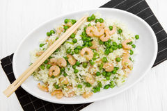 Dish with rice and shrimps and peas Royalty Free Stock Image