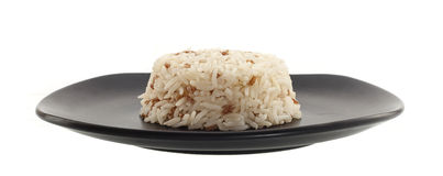 Dish of rice on white Royalty Free Stock Photos