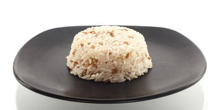 Dish of rice on white Stock Photography