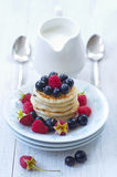 Dish with ripe raspberries, black currants and pancakes Stock Photography
