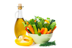 The dish of ripe vegetables and glass jar with olive oil Royalty Free Stock Photos