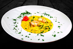 Dish with risotto, shrimp and tomato. stock photos
