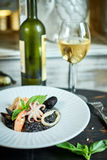 Dish of risotto with squid ink on grey plate jpg Stock Photo