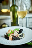 Dish of risotto with squid ink on grey plate jpg Stock Photography