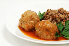 Dish with rissole and buckwheat. In grav Royalty Free Stock Image