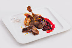 Dish of roast duck with sauce Stock Images