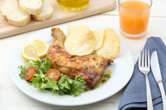 Dish of roasted chicken leg Stock Photo