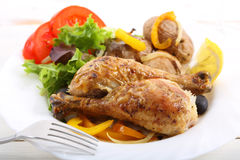 Dish of roasted chicken legs Royalty Free Stock Photos
