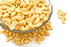 Dish with roasted peanuts. Dish with tasty peanuts on white background closeup Royalty Free Stock Photography