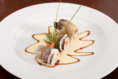 Dish with rolled fish and shrimps Stock Photo