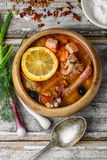 Dish of Russian cuisine-beef stew. Traditional Solyanka with smoked meats in wooden plate Royalty Free Stock Image