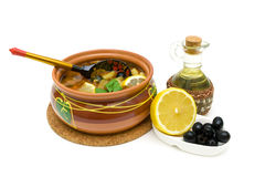 Dish of russian hodgepodge soup in ceramic pot on white backgrou Royalty Free Stock Photography