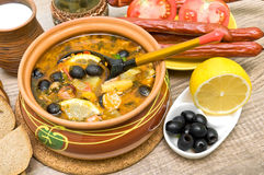 Dish of russian hodgepodge soup and other food. Royalty Free Stock Images