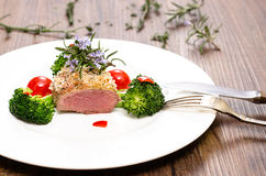 Dish with saddle of lamb Royalty Free Stock Photography