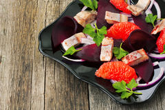 Dish with a salad of herring, beetroot and grapefruit Stock Photography