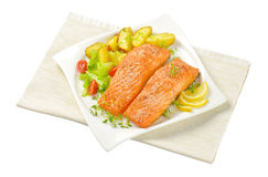 Dish of salmon fillets with roasted potatoes Royalty Free Stock Photos