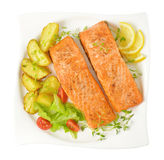 Dish of salmon fillets with roasted potatoes Royalty Free Stock Photo