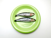 Dish with sardines. First flat white background Stock Photo