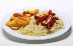 Dish with Sauerkraut Sausages and Potatoes Stock Images