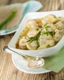 Dish of savory pork tortellini in broth pelmeni russian Stock Photo