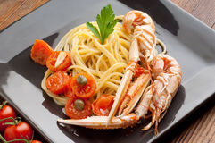 Dish with scampi spaghetti Stock Image