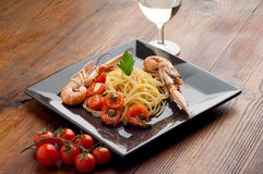 Dish with scampi spaghetti Stock Photo